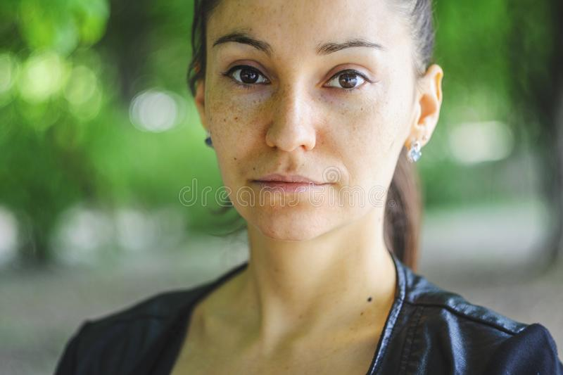 Outdoors portrait of a beautiful brown-eyed woman stock photo