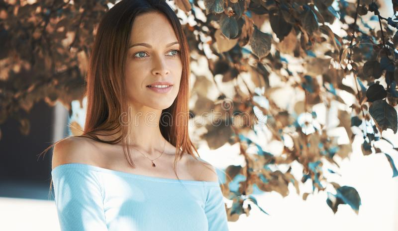 Outdoors portrait of a beautiful girl in the park royalty free stock image