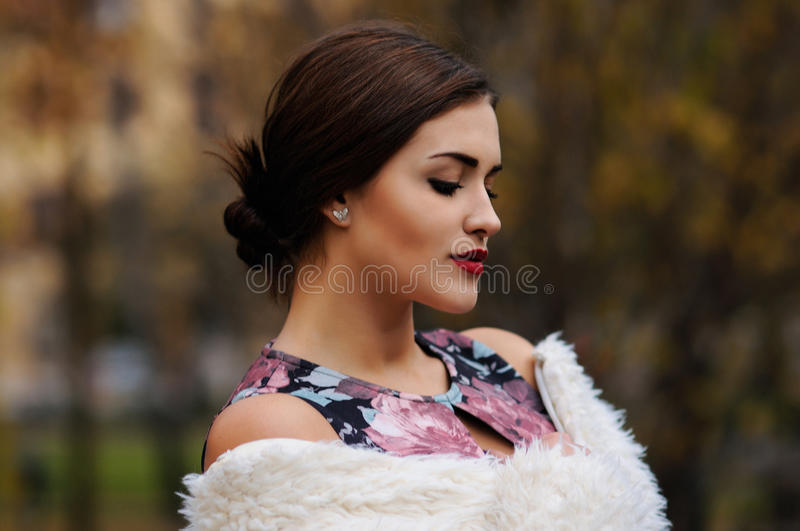 Outdoors portrait of beautiful young woman with big eyes and red royalty free stock images