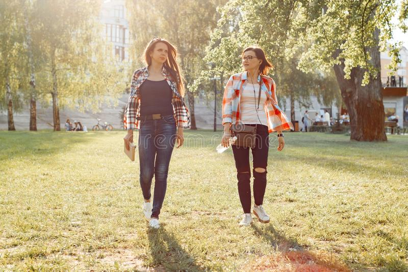 Outdoors portrait of female friends exercising and walking outside together stock photography
