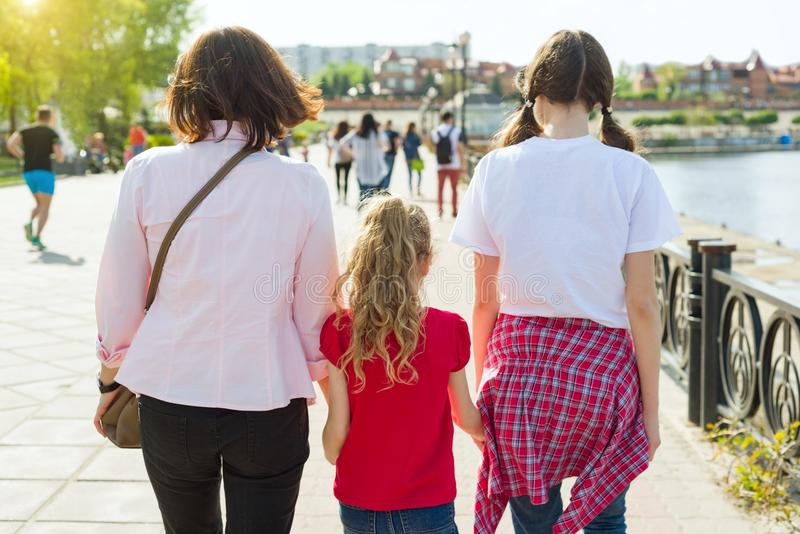 Outdoors portrait of mother and two daughters. stock photos