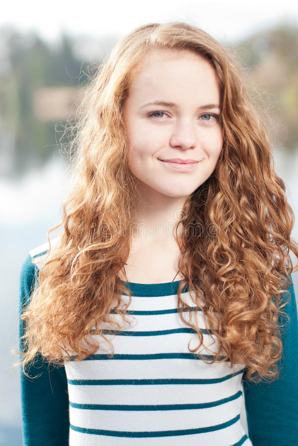 Outdoors portrait of pretty young girl. stock photos