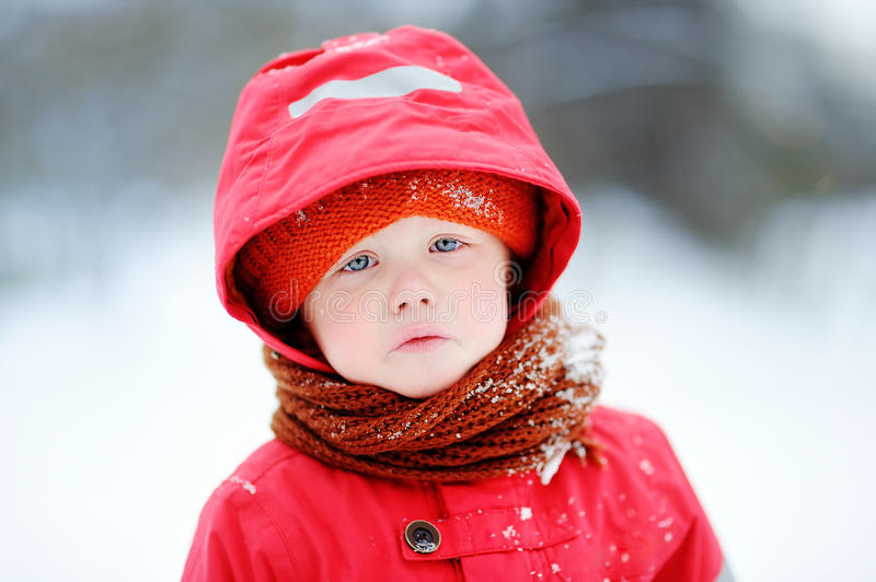 Outdoors portrait of sad crying little boy in winter stock photos
