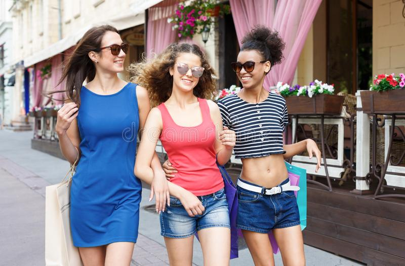Happy girls having fun while walking in the city stock photo