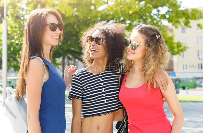 Happy girls having fun while walking in the city stock photography