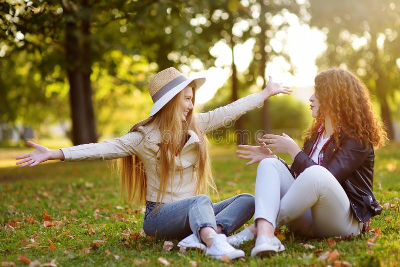 Outdoors portrait of two delightful young woman. Variety of female beauty. Two caucasian girls friend stroll together in sunny day. Girlfriends. Communication stock images