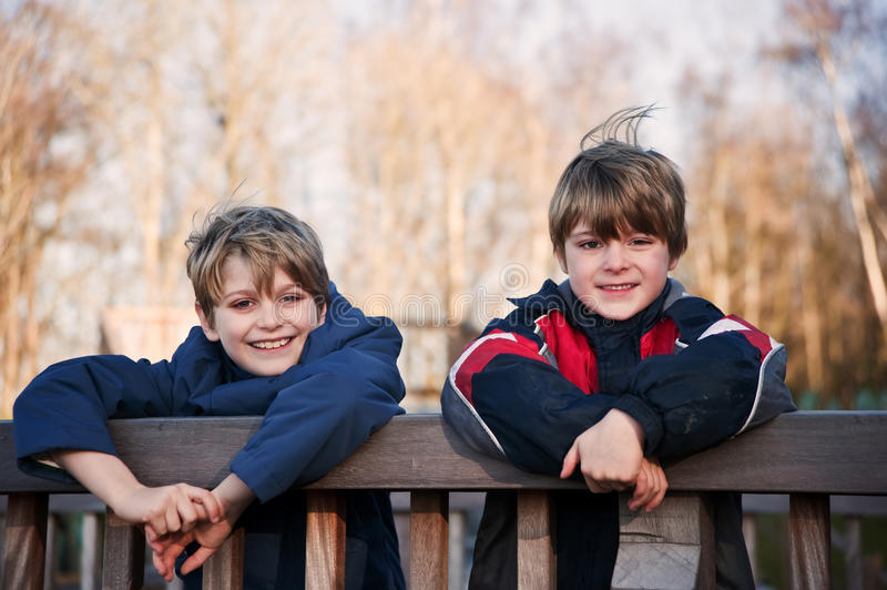Outdoors portrait of two young happy brothers royalty free stock photography