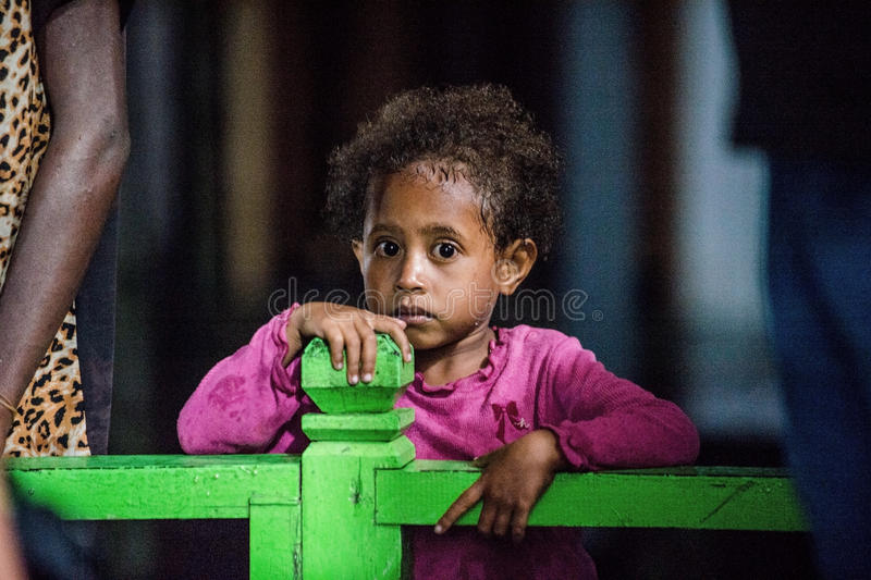 Outdoors Portrait of unidentified Papuan little girl. royalty free stock photography