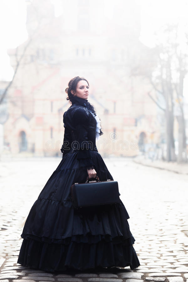 Outdoors portrait of a victorian lady in black stock image