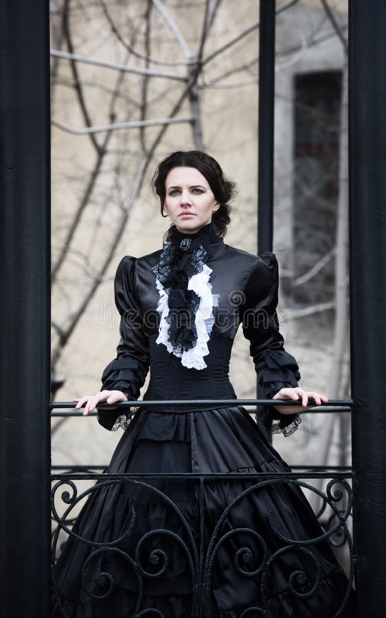 Outdoors portrait of a victorian lady in black stock photos