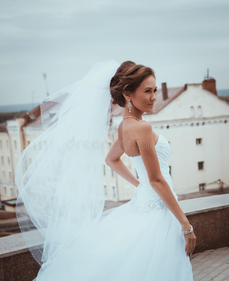Outdoors portrait of young beautiful bride in city streets stock photography