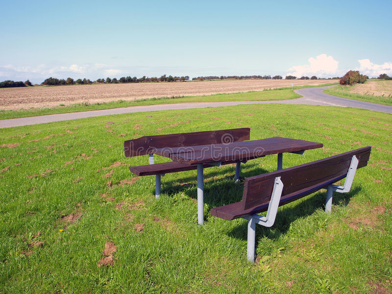 Outdoors relaxing Picnic table. Outdoors Picnic table setting Denmark - relaxing in nature stock photography