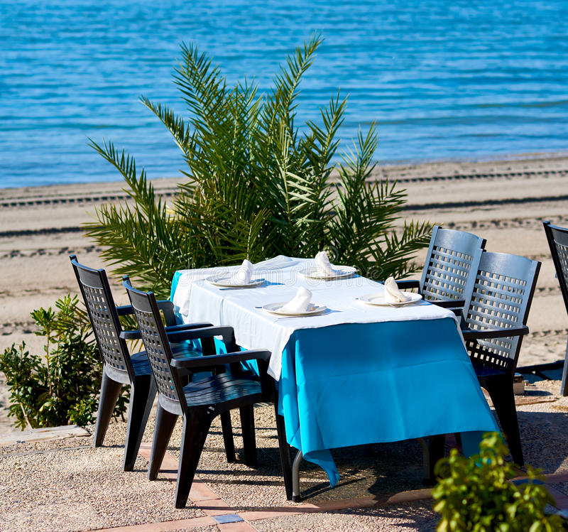 Outdoors restaurant in La Manga. Spain. Outdoors restaurant near the beach in La Manga La Manga del Mar Menor, is a seaside spit in the Region of Murcia, Spain royalty free stock photography