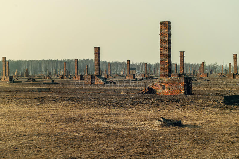 The outdoors,ruins and barbed wire fence of the infamous Auschwitz II-Birkenau, a former Nazi extermination camp and now a museum stock photography