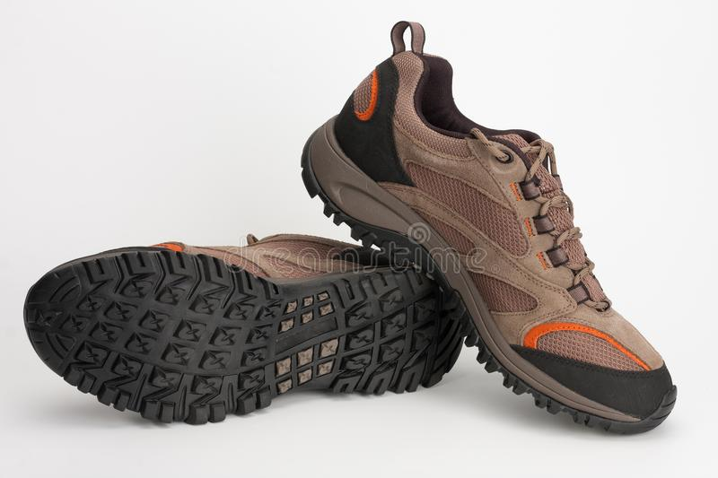 Outdoors shoes for man for hiking, trekking, climbing and walki. Ng, studio shoot on white background royalty free stock photo