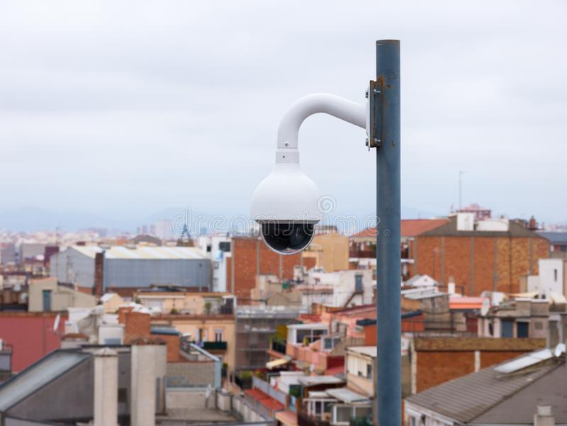 Outdors security camera with a major city in background stock images