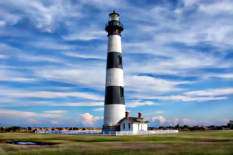 The Outer Banks`Bodie Island lighthouse is @50` shorter than its neighbor Hatteras Lighthouse royalty free stock photo