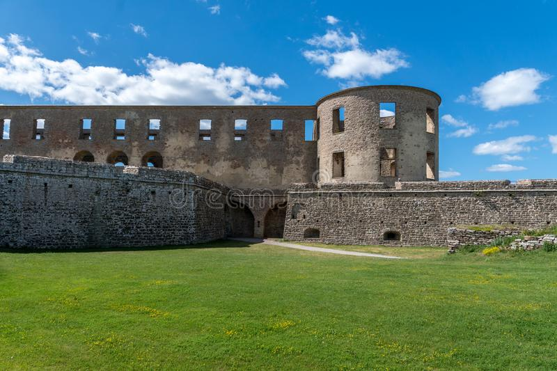 Outer corner of the castle ruin Borgholm in Sweden. On a beautiful summer day with sunshine, blue sky and green grass royalty free stock image