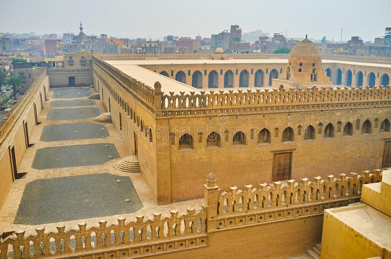 The citadel of Ibn Tulun mosque, Cairo, Egypt. The outer and inner walls of medieval Ibn Tulun mosque, decorated with carved battlements and arched windows; the royalty free stock photos