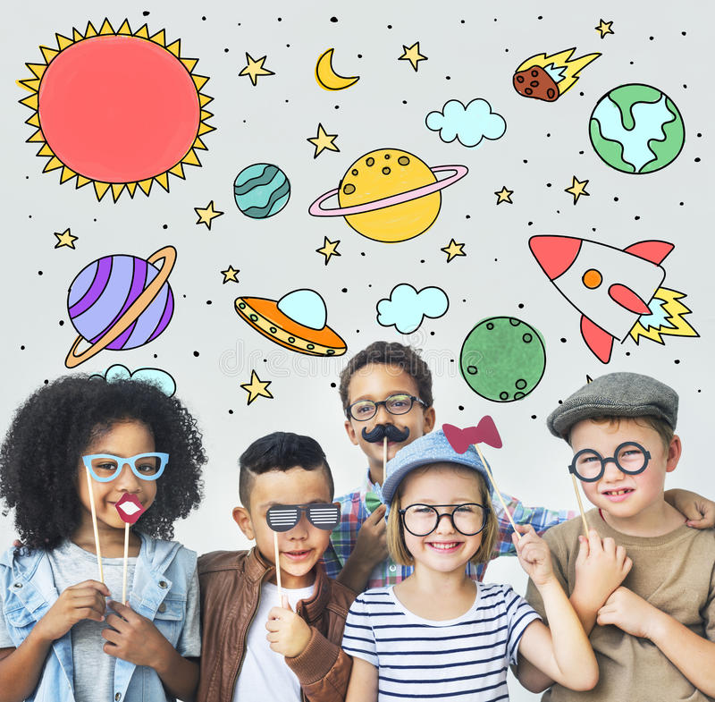 Outer Space Icons Drawing Graphics Concept. Diverse children having fun with masks stock photo
