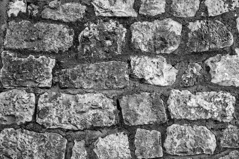 The outer wall of large stones stock images