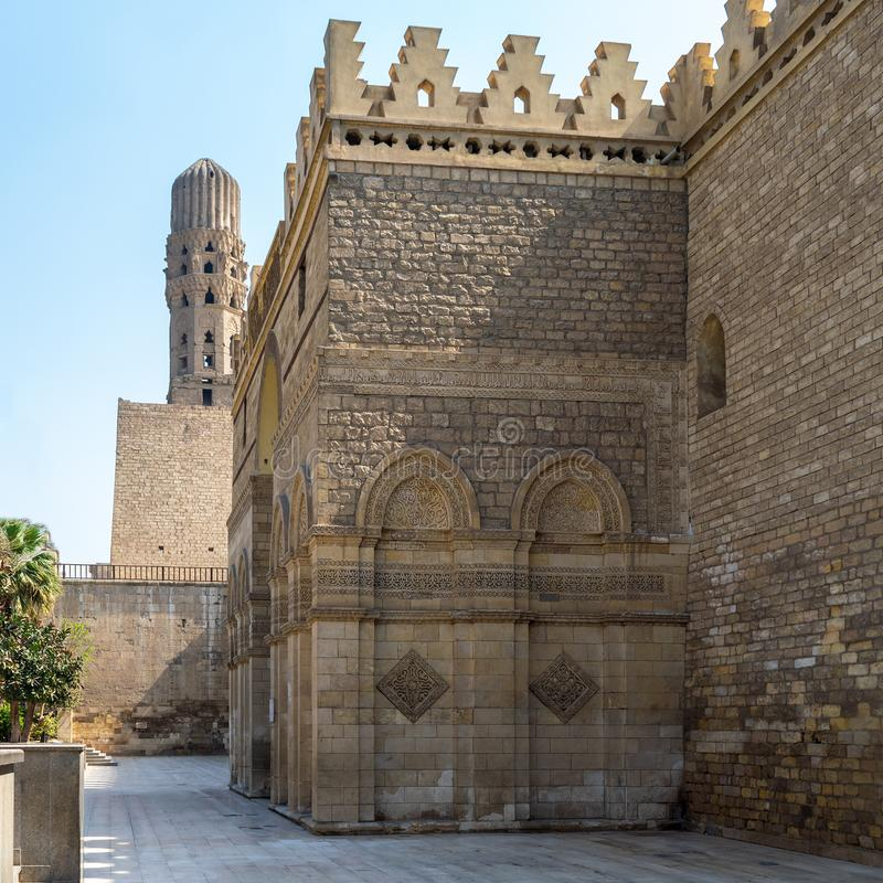 Outer wall and minaret of public historic Al Hakim Mosque - Enlightened Mosque - Moez Street, Cairo. Outer wall of public historic Al Hakim Mosque known as The royalty free stock image