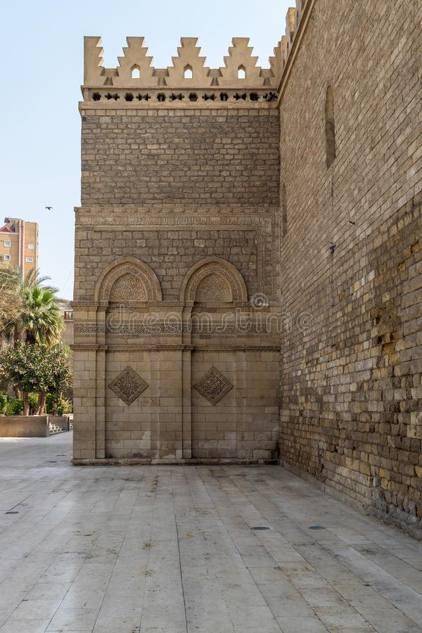 Outer wall of public historic Al Hakim Mosque - Enlightened Mosque - Moez Street, Cairo. Outer wall of public historic Al Hakim Mosque known as The Enlightened royalty free stock image