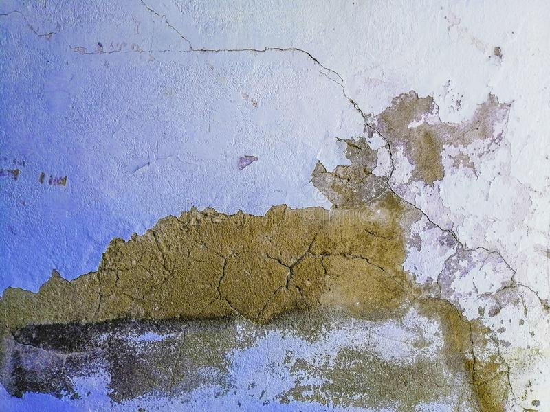 The outer wall of the room has cracks and peeling paint, Peeling paint on a wall surface stock image