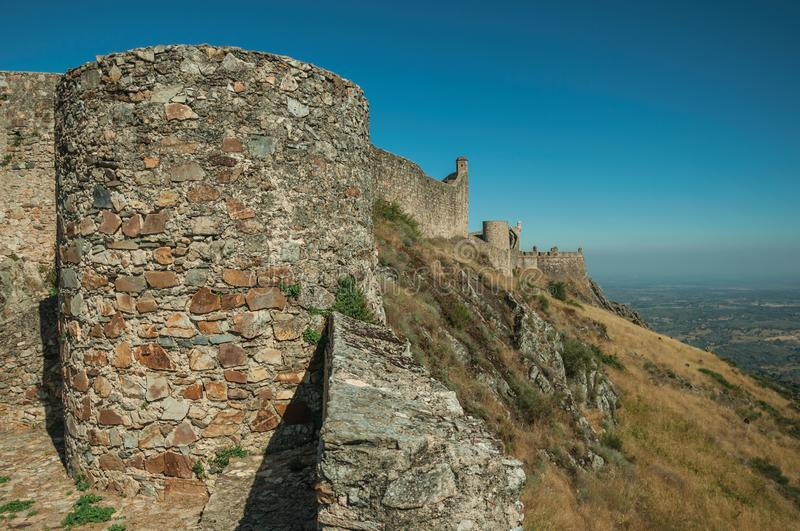 Outer walls and towers over rocky hill at the Marvao Castle royalty free stock photos