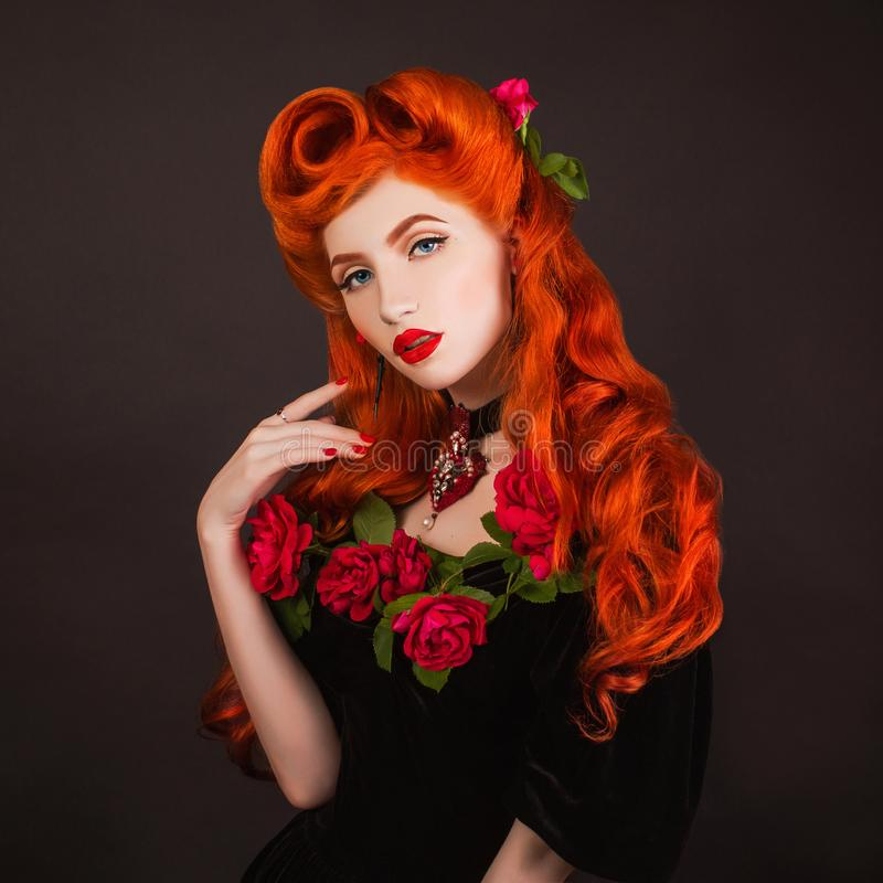Outfit for halloween party. Beauty redhead model with hairdo on black background. Victorian witch in halloween goth outfit. stock images