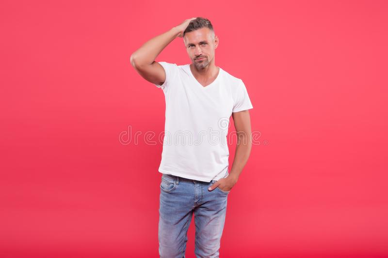 Daily outfit. Man model clothes shop. Menswear and fashionable clothing. Man calm face posing confidently red background. Man looks handsome in casual shirt royalty free stock photography