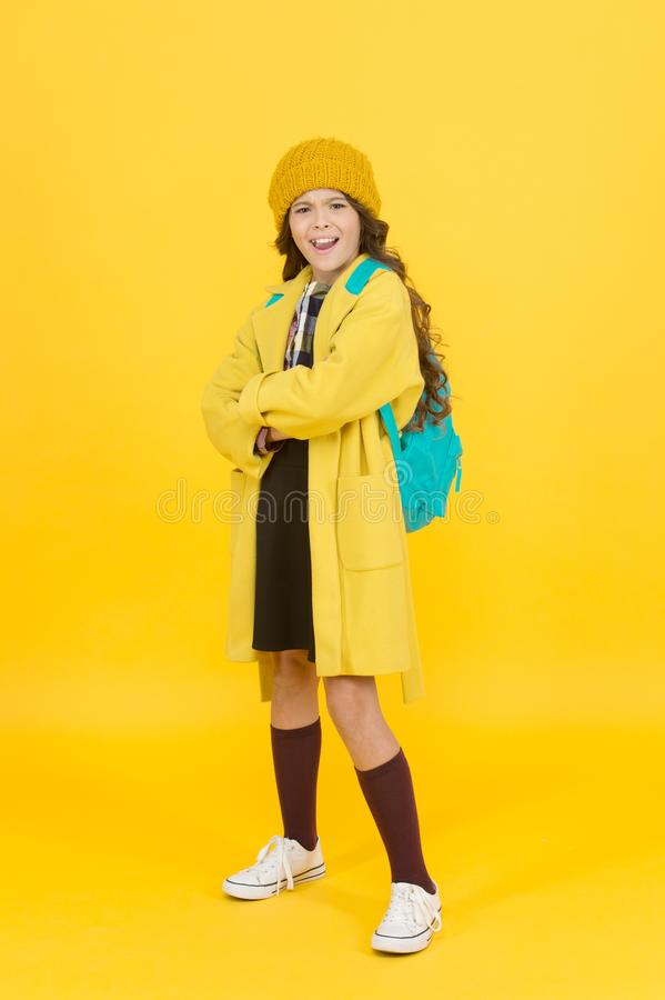 Outfit for daily school life. Feeling cool and stylish. Fall fashion. Little girl wearing stylish hat and coat. Schoolgirl fancy child. Aesthetics of clothes stock photos