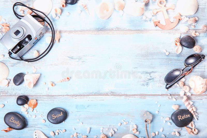 Outfit of traveler on blue wooden background with copy space, Travel concept stock photography