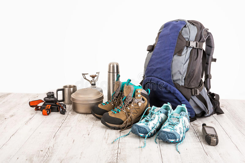 Outfit of traveler, climber, student, teenager. Overhead of essentials for modern sport young person. Different objects on wooden stock images