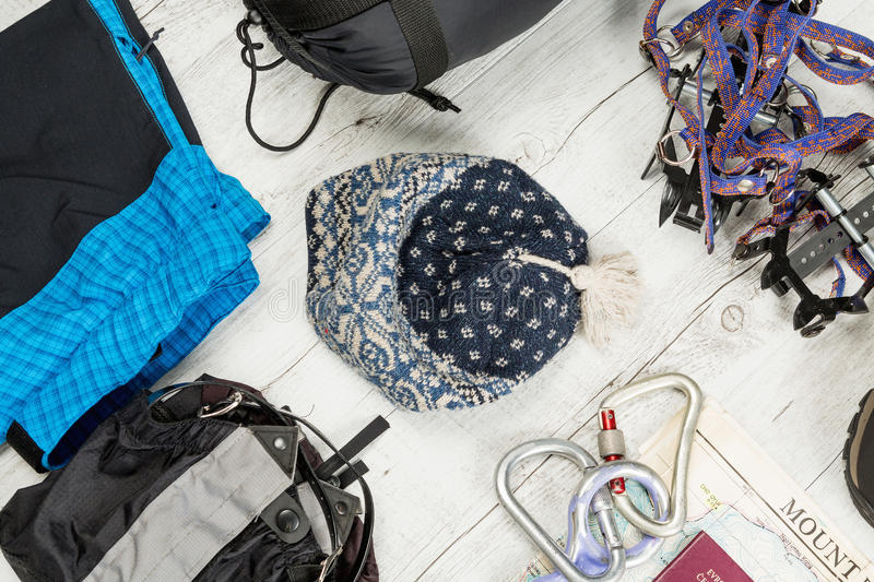 Outfit of traveler, climger, student, teenager. Overhead of essentials for modern sport young person. Different objects on wooden royalty free stock image