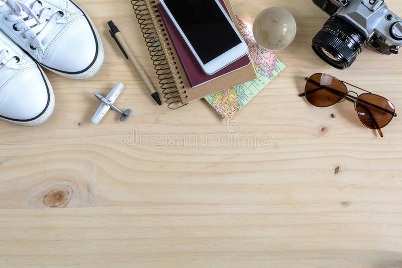 Outfit of traveler on wooden background and copy space, Travel c royalty free stock images