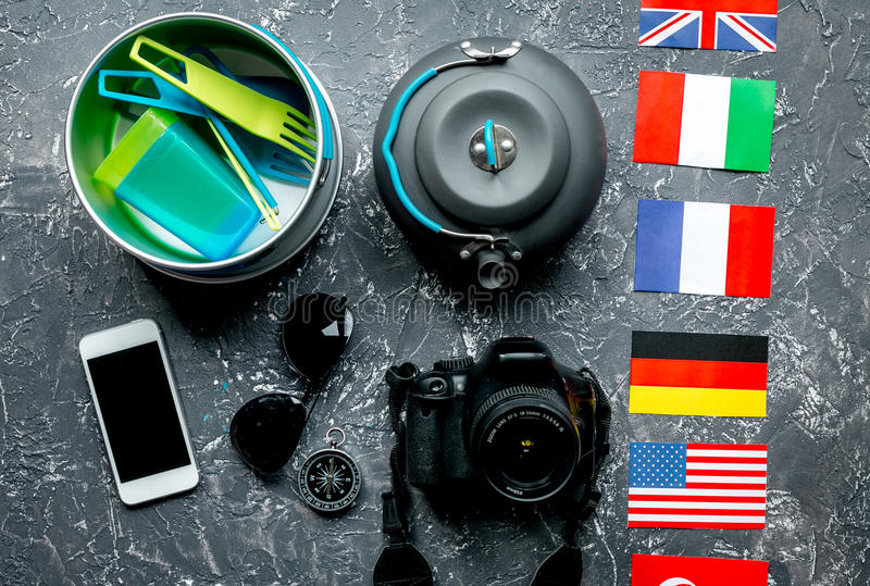 Outfit of traveller with flags and plastic glasses gray background top view royalty free stock photo