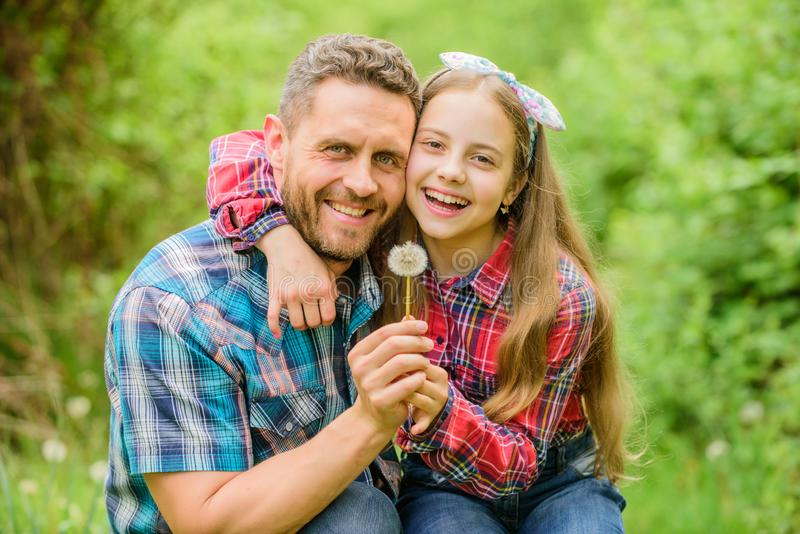 Outgrow allergies. Biggest pollen allergy questions. Father little girl enjoy summertime. Dad and daughter blowing royalty free stock images