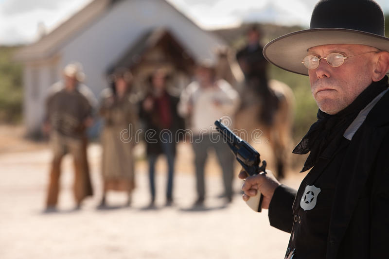 Outgunned Sheriff at Showdown. Outgunned sheriff in old American west showdown royalty free stock photography