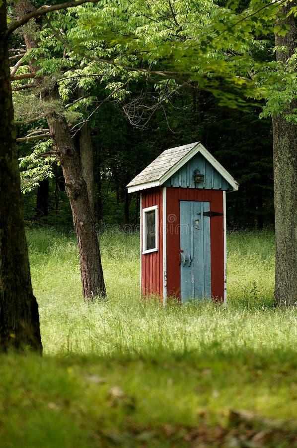 outhouse страны причудливый стоковые изображения