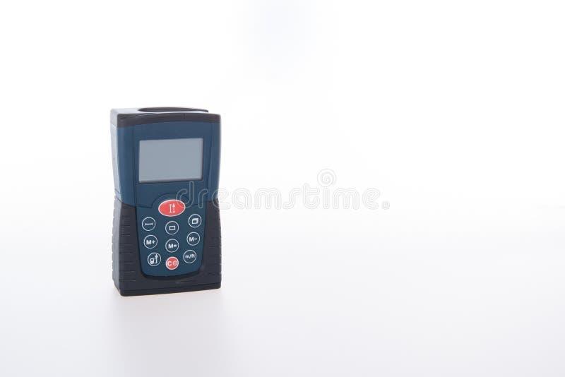 Outil architectural ou télémètre de laser sur un fond photos stock