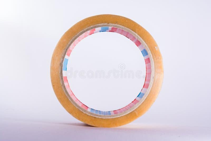 Outil de construction d'industrie d'emballage d'espace libre de ruban adhésif de petit pain images stock