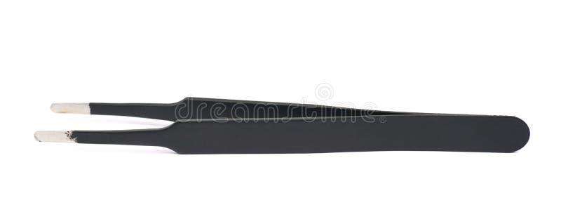 Outil noir de brucelles d'isolement photographie stock