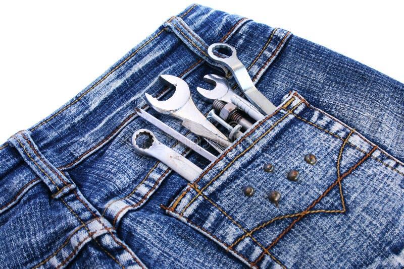 Outils dans la poche de jeans images stock