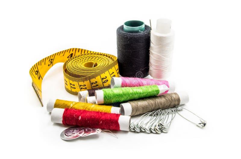 Outils de couture sur le fond blanc photos libres de droits