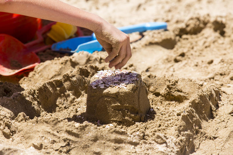 Outils de pâté de sable et de jouet photographie stock libre de droits