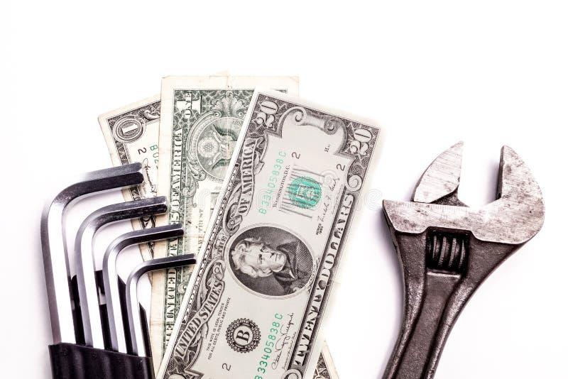 Outils de travail se trouvant avec l'argent photos libres de droits
