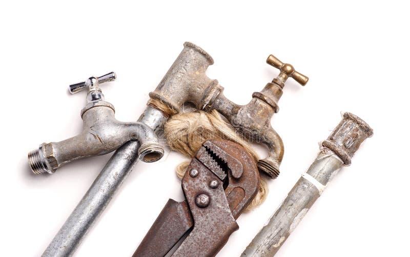 Outils de travail, tuyauterie, tuyaux et robinets photo libre de droits