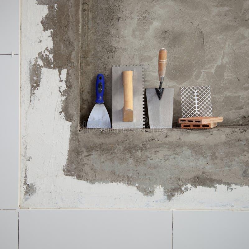 Outils de truelle d'acier inoxydable de construction images stock
