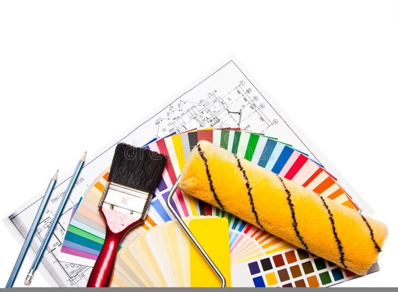 Outils et guide de couleur sur le blanc images stock